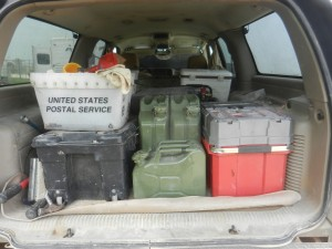 NATO Jerry Cans in the back of the Big Ass Suburban.  10l in front, 2x20 liter behind