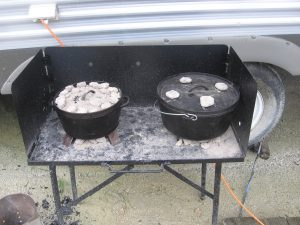 Lodge dutch ovens on a Lodge steel cooking table